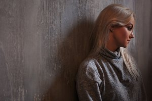 Depressed woman. blonde girl sitting