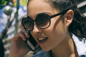 Young woman talking with her phone
