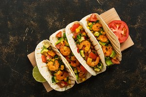 Shrimps tacos with salsa, vegetables