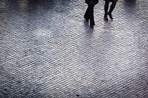 People walking on a cobblestones