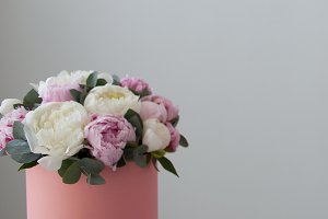 chic bouquet of peonies in a gift