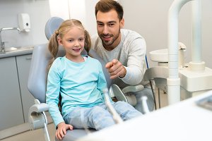 father and daughter in dentist offic