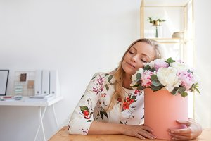 woman in a modern office with flower