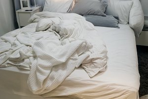 Close up white bedding sheets and