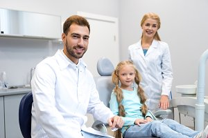 young male and female dentists with