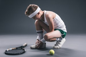 preteen boy in sportswear with tenni