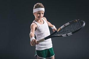 portrait of boy in sportswear with t