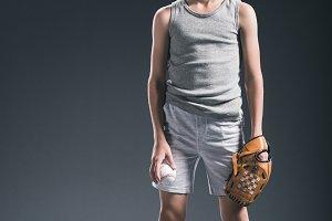 preteen boy in cap with baseball glo