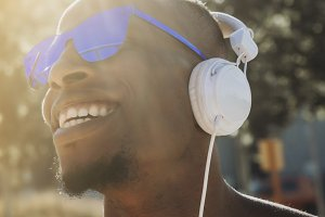 Afro man with headphones and sunglas