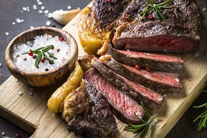 Grilled beef steak ribeye on wooden