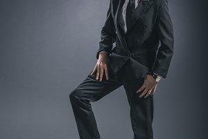 boy dressed as businessman with socc