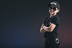 portrait of smiling boy in policeman
