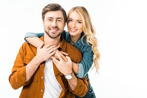 portrait of cheerful couple embracin