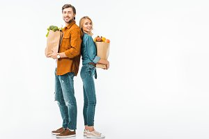 happy couple with shopping bags full