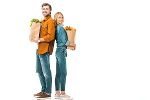 cheerful couple with shopping bags f