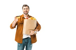 positive man with shopping bag full
