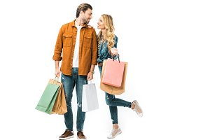 couple holding colorful shopping bag