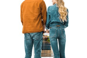 rear view of couple carrying shoppin