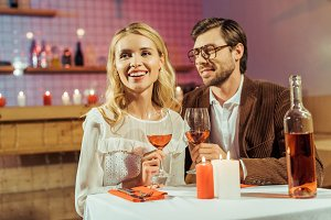 young couple with wine glasses celeb