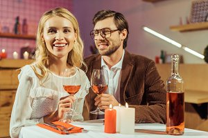 laughing couple with wine glasses ce