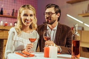 happy couple with wine glasses celeb