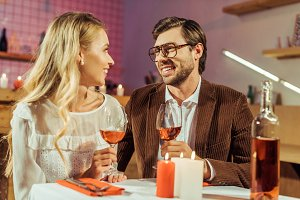 couple with wine glasses celebrating