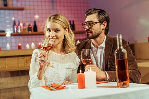 smiling couple with wine glasses cel