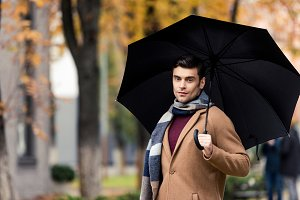 attractive stylish man in coat and s