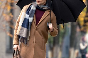 attractive stylish man in coat with