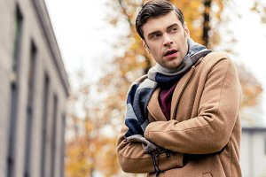 bottom view of handsome man in coat