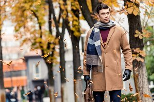 handsome stylish man in coat walking
