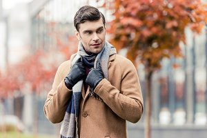 stylish man in coat, leather gloves