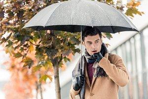 handsome stylish man with umbrella s