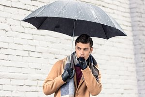 stylish man in coat and scarf with u