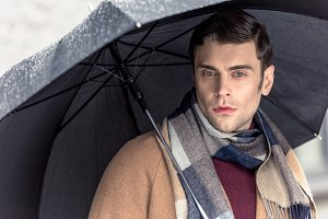 handsome man in coat and scarf with