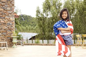 Little asian girl American flag