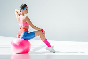 athletic young woman sitting and exe
