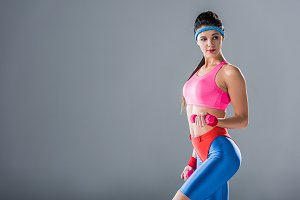 sporty young woman training with dum