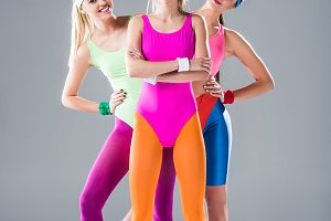 three athletic young women standing