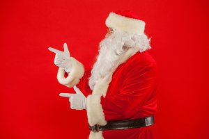 Santa Claus pointing in blank a