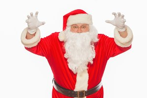 Shocked Santa Claus raising his