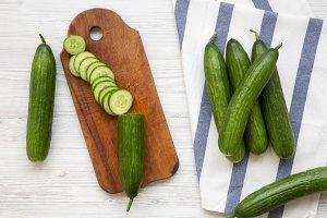 Fresh raw green cucumbers, top view.