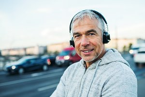 Mature male runner with headphones