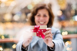 A senior woman with a present in