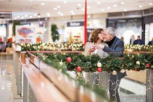 Senior couple with present doing