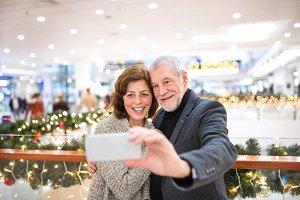 Senior couple with smartphone taking