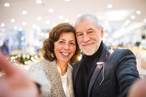 Senior couple taking selfie in