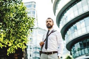 Hipster businessman walking outdoors