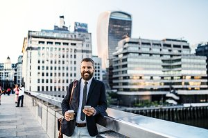 Hipster businessman with coffee and