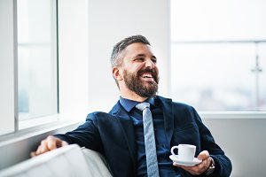 A portrait of businessman with a cup